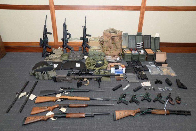 The stockpile of guns found by investigators owned by Christopher Hasson.
