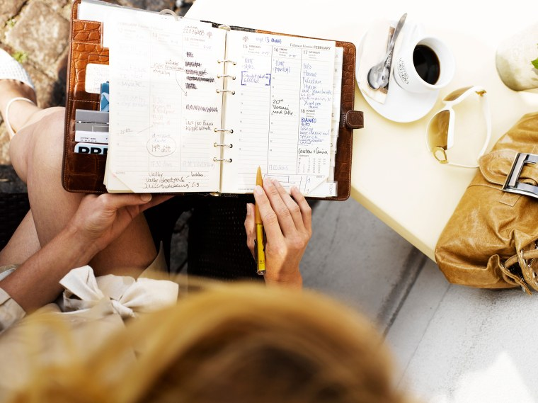Image: Woman at an outdoor restaurant with her day planner. Image shot 2007. Exact date unknown.