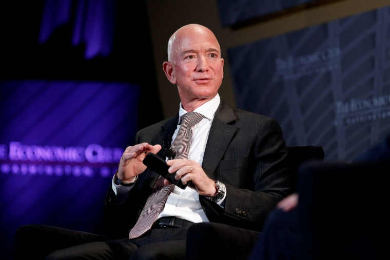 "Image: Jeff Bezos, president and CEO of Amazon and owner of The Washington Post, speaks at the Economic Club of Washington DC's ""Milestone Celebration Dinner"" in Washington"