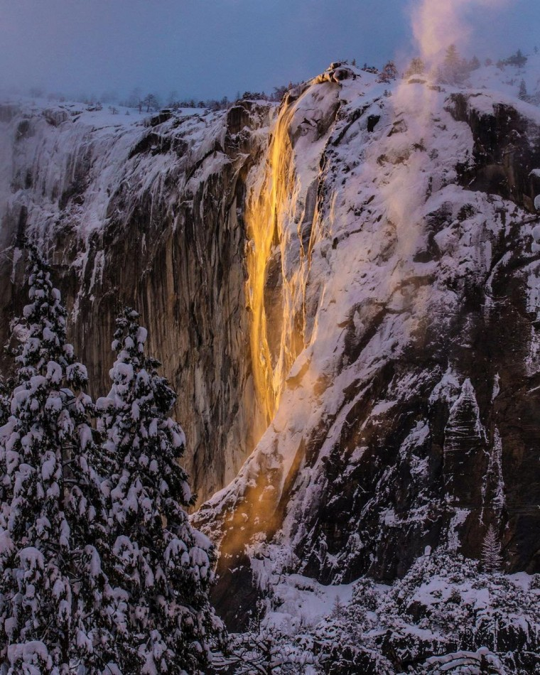 """Image: Sunlight hits the Horsetail Fall, turning it into a \""""Firefall\"""",  at Yosemite National Park, California"""