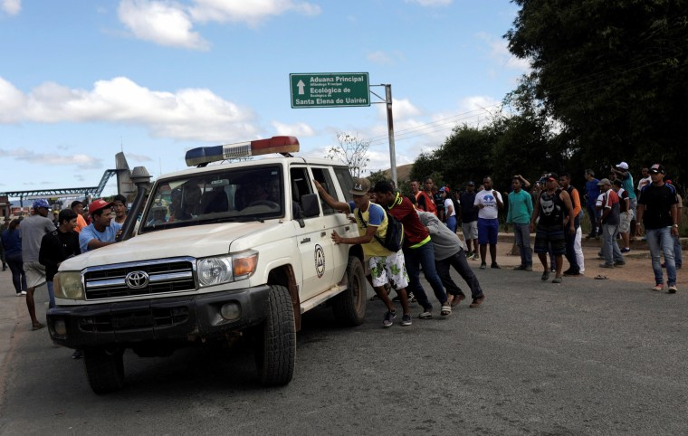 Image: An ambulance carrying people that were injured during clashes is assisted at the border between Venezuela and Brazil on Feb. 22, 2019.