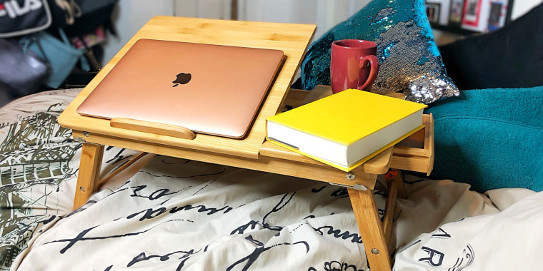 Set up on my bed, this sturdy little bed table never tips over. Seriously.