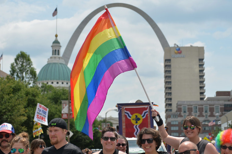A participant waves a rainbow colored flag during the annual PrideFest parade in St. Louis, Missouri on June 28, 2015. The US Supreme Court made same-sex marriage legal throughout the nation Friday in a much-awaited landmark decision that triggered wild jubilation and tears of joy across the country. AFP PHOTO/ MICHAEL B. THOMAS        (Photo credit should read Michael B. Thomas/AFP/Getty Images)