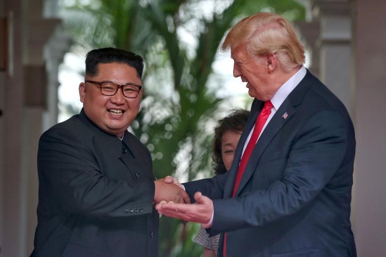 Image: U.S. President Donald Trump meets North Korean leader Kim Jong Un at the Capella Hotel on Sentosa island in Singapore