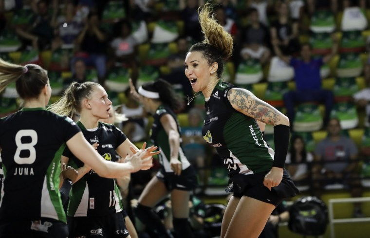Image: Bauru volleyball player Tiffany Abreu celebrates with teammates in Brazil on Dec. 19, 2017.