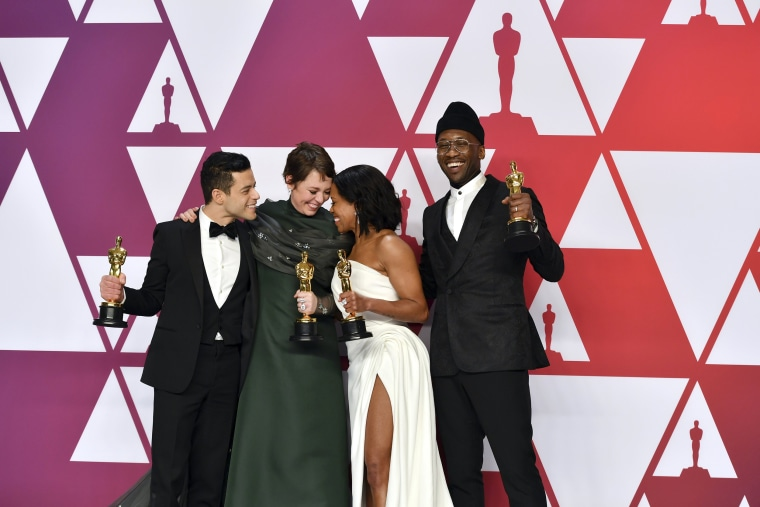 Image: Rami Malek, Olivia Colman, Regina King and Mahershala Ali celebrate their Academy Award wins at the Oscars on Feb. 24, 2019.