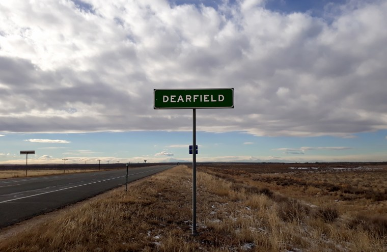 Image: A sign for Dearfield on Highway 34 in Colorado.