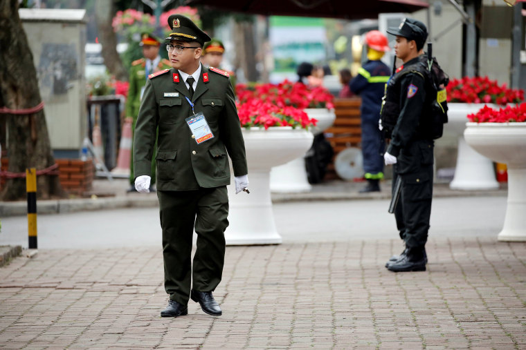 Image: Security officers stand guard at Melia Hotel before the Trump-Kim summit in Hanoi