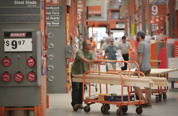 Customers shop at Home Depot in Chicago on July 26, 2017.