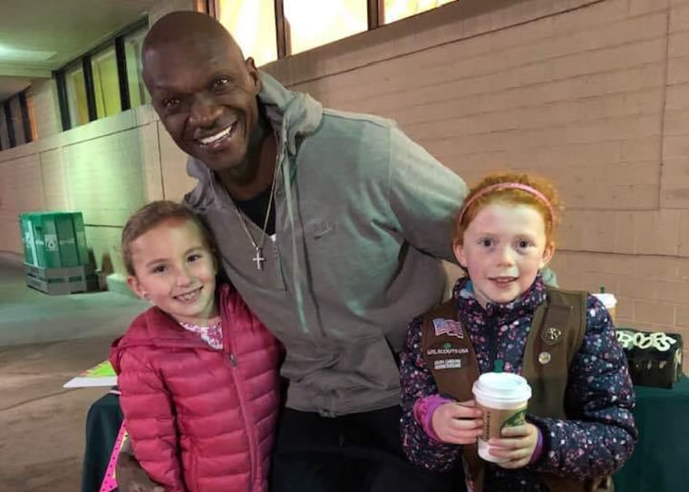 Image: Detric Lee McGowan, center, bought $500 worth of Girl Scout cookies in Greenville, South Carolina, on Feb. 22, 2019.