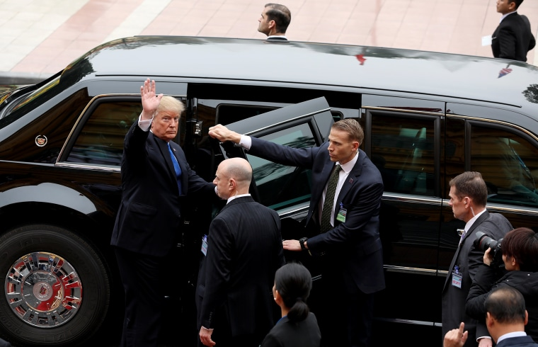 Image: President Donald Trump waves after a meeting in Hanoi, Vietnam, on Feb. 27, 2019.
