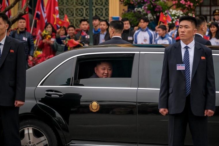 Image: Kim Jong-Un waves from his car after arriving in Lang Son, Vietnam, on Feb. 26, 2019.