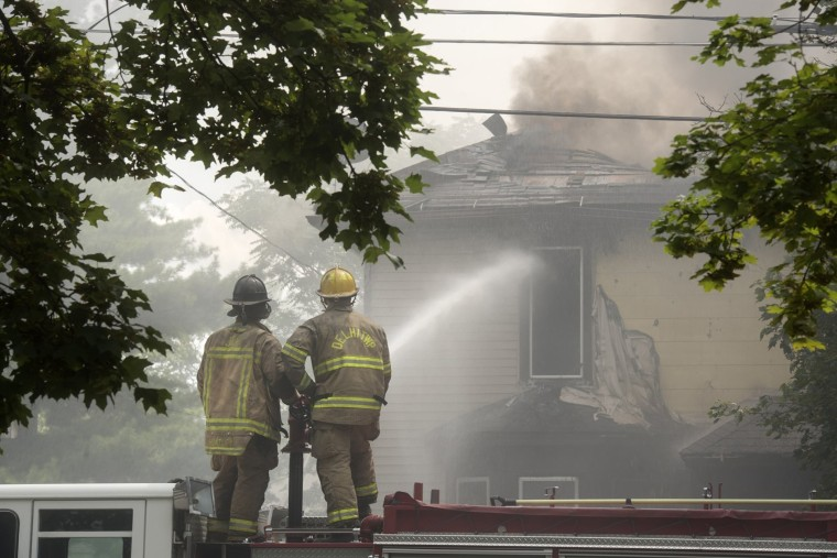 Firefighters respond to a fire at the house of Nikki Joly in Aug. 2017 in Jackson, Michigan.