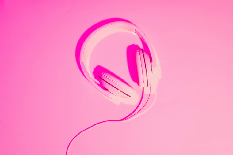pink toned picture of headphones on pink background
