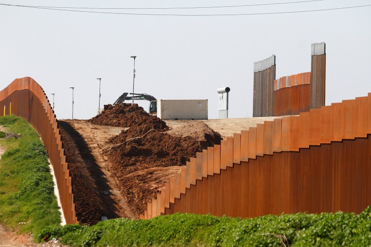 Image: A general view shows a new section of actual border fencing near San Diego, California, as seen from Tijuana