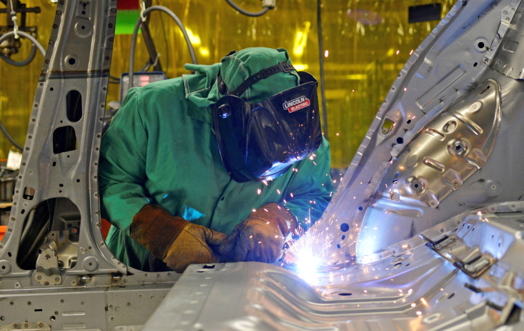 Image: FILE PHOTO: Line workers spot weld parts of the frame on the flex line at Nissan Motor Co's automobile manufacturing plant in Smyrna Tennessee