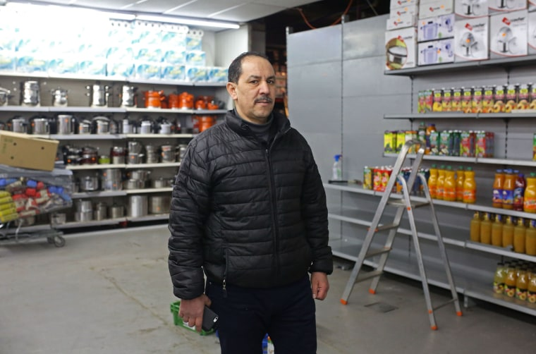 Image: Bouihrouchane Mbark pictured alongside the empty meat section of his halal supermarket, Aswak Souss
