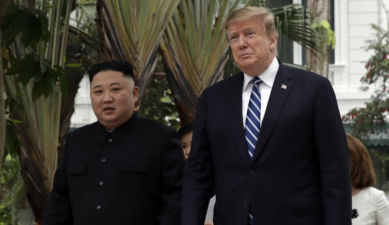 Image: President Donald Trump and North Korean leader Kim Jong Un take a walk after their first meeting at the Sofitel Legend Metropole Hanoi hote