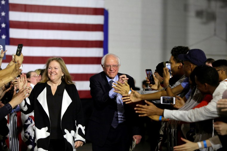Image: 2020 U.S. presidential candidate and U.S. Senator Bernie Sanders and his wife Jane O'Meara Sanders acknowledge the crowd