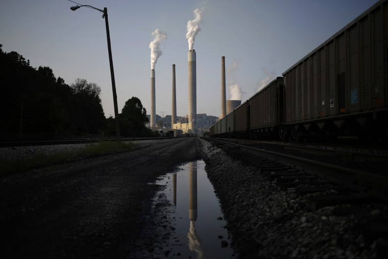 Image: Emissions rise from the American Electric Power Co. Inc. coal power plant in Winfield, West Virginia, on July 31, 2014.