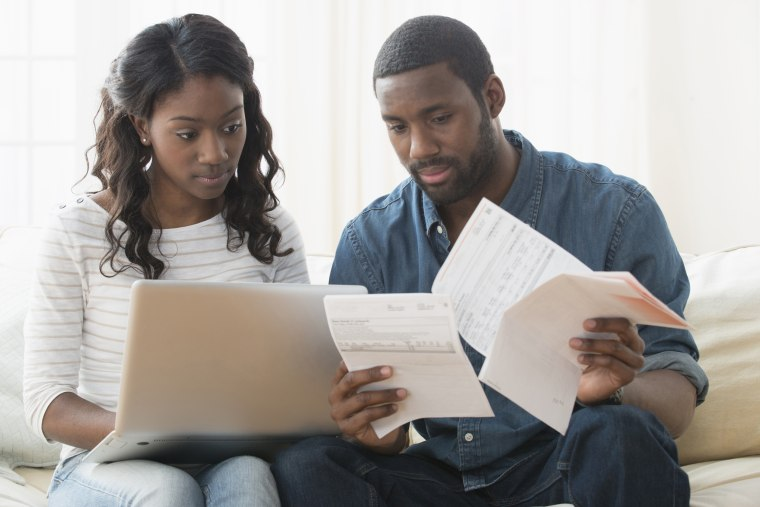 Couple paying bills on laptop