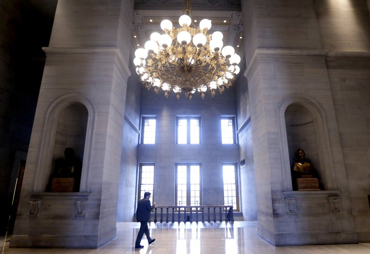A man walks through the hall outside the House and Senate chambers, in Nashville, Tennessee on Jan. 7, 2019.
