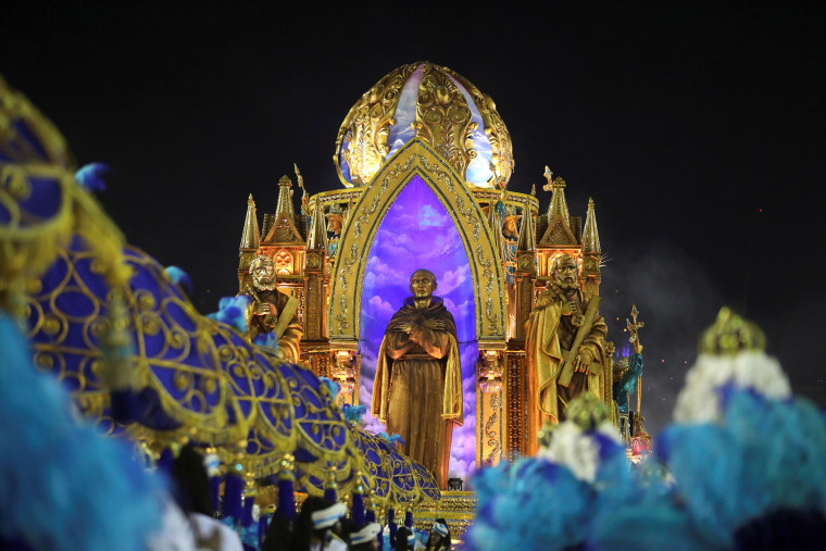 Image: Revellers from Vila Isabel samba school perform during the second night of the Carnival parade at the Sambadrome in Rio de Janeiro