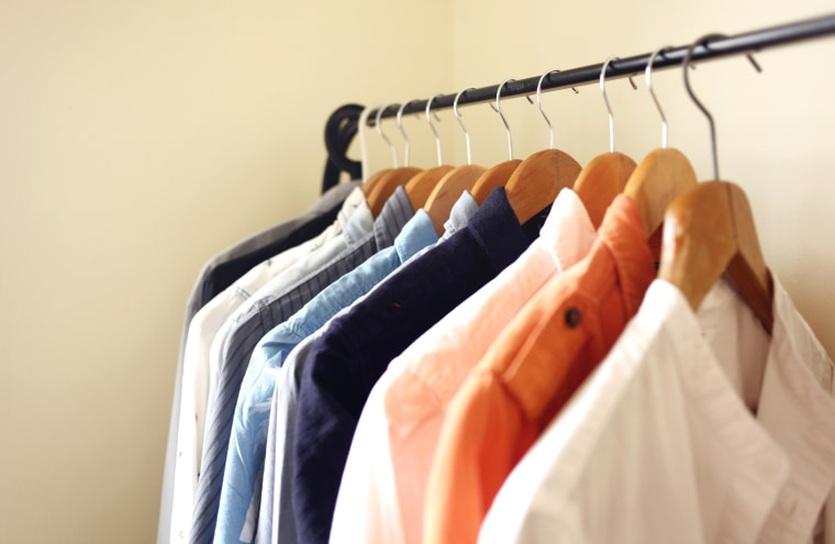 Image: Open wardrobe is usually adapted for a small living space. The shirts, dresses or coats are hanged on a clothing rail,