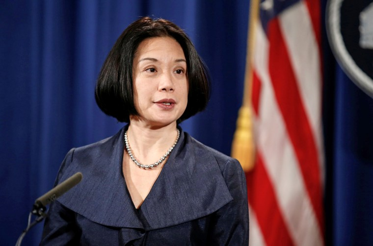 """Image: United States Attorney for the District of Columbia Jessie Liu speaks during a news conference to discuss """"efforts to reduce violent crime"""" at the Department of Justice in Washington"""