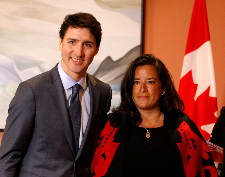 Image: Newly appointed Canadian Veterans Affairs Minister Jody Wilson-Raybould poses for a photo with Prime Minister Justin Trudeau