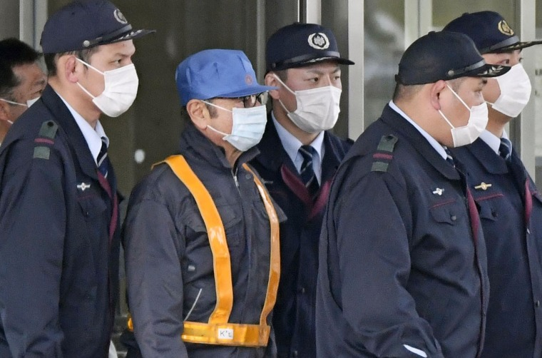 Image: A masked man, believed to be former Nissan Chairman Carlos Ghosn, leaves Tokyo's Detention Center on Wednesday.