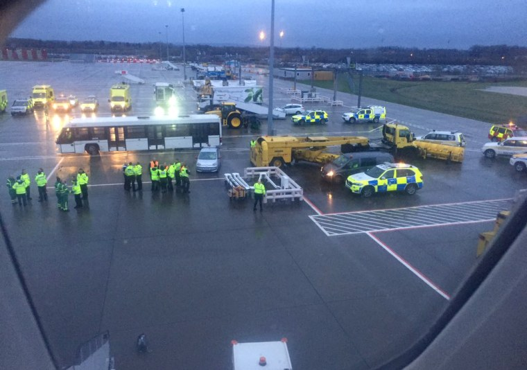 Image: Emergency personnel wait for passengers to disembark a flight from Barbados at Gatwick Airport in England on March 6, 2019.
