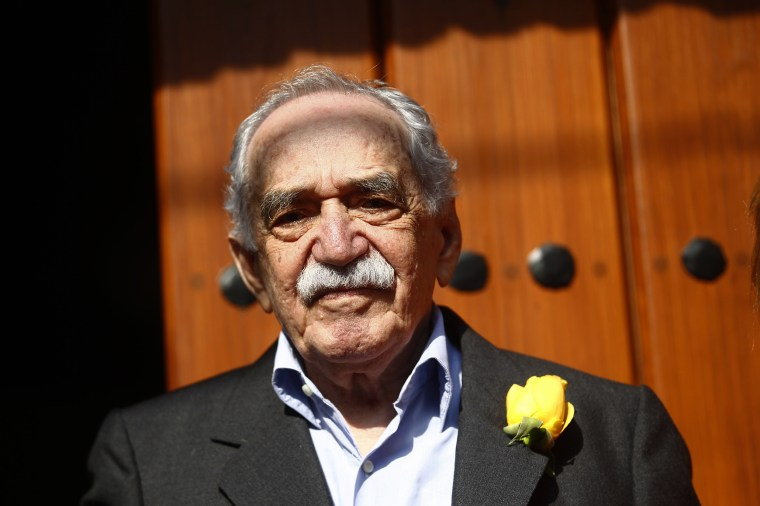 Gabriel Garcia Marquez stands outside his house on his 87th birthday in Mexico City