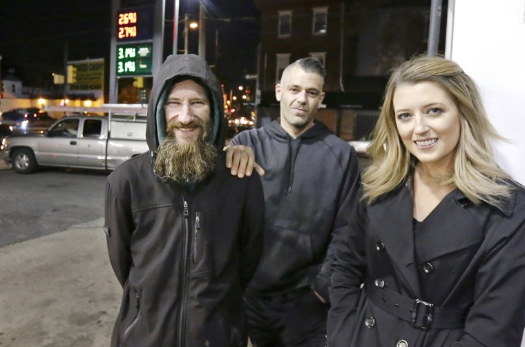 Johnny Bobbitt Jr., Kate McClure, and McClure's boyfriend Mark D'Amico at a Citgo station in Philadelphia on Nov. 17, 2017.