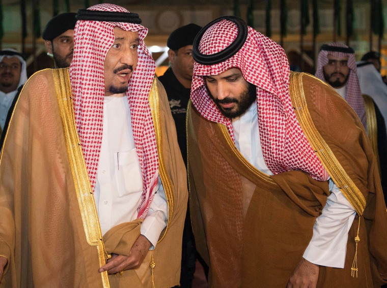 Image: Saudi Arabia's King Salman bin Abdulaziz Al Saud chats with his son and Crown Prince Mohammed bin Salman in Riyadh