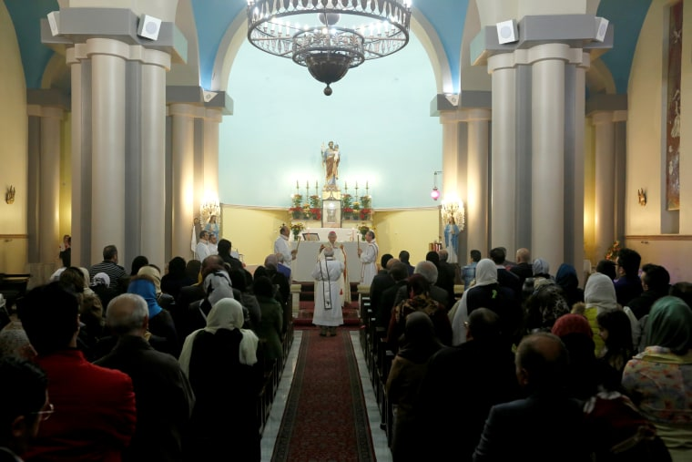 Image: Iranian Christians attend Christmas Eve mass at the St. Joseph Armenian Catholic Church in Iran on Dec. 24, 2016.