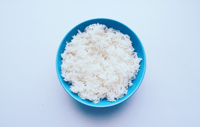 Directly Above Shot Of Rice In Bowl Over White Background