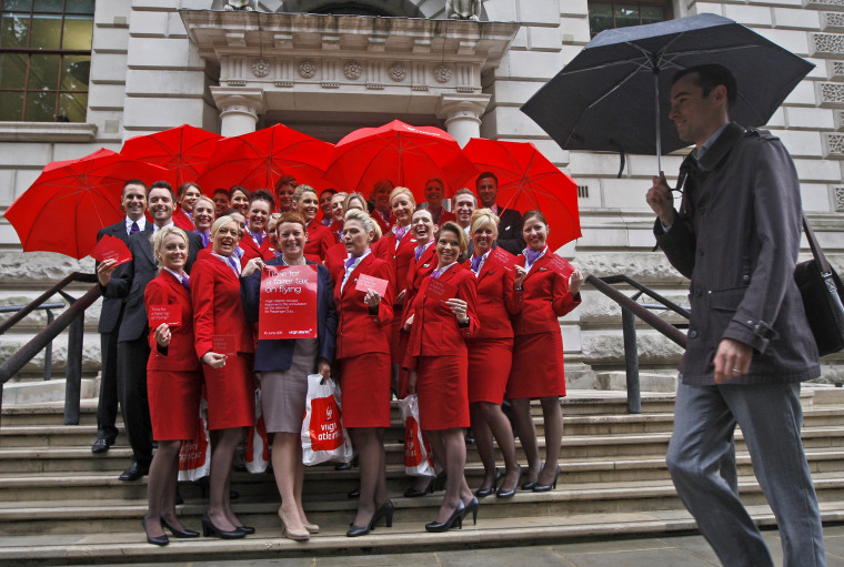 Image: Virgin Atlantic Cabin Crew pose for photographs in London on June 16, 2011.