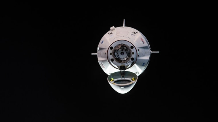 Image: he uncrewed SpaceX Crew Dragon spacecraft is the first Commercial Crew vehicle to visit the International Space Station. Here it is pictured with its nose cone open revealing its docking mechanism while approaching the station's Harmony module on M