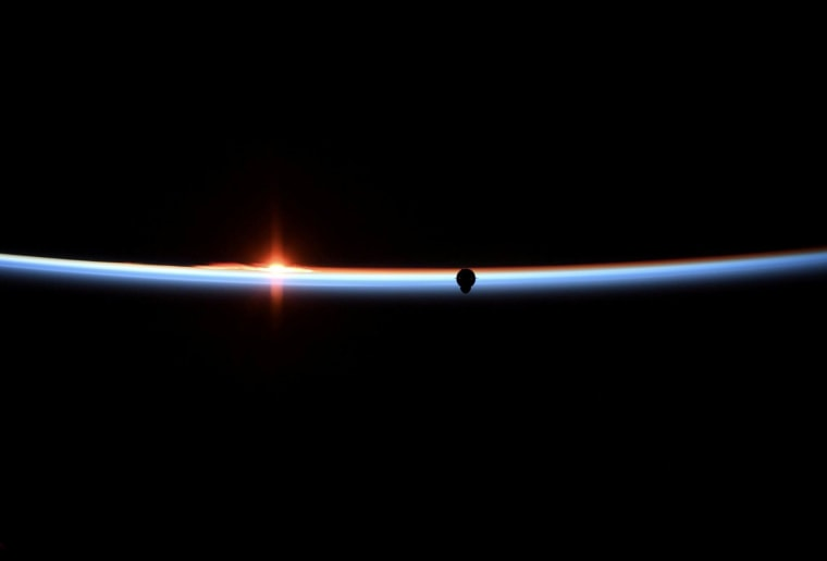 Image: The SpaceX Crew Dragon capsule approaches in a photograph taken by NASA astronaut Anne McClain aboard the International Space Station