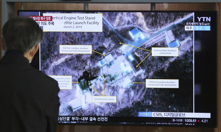 Image: A man watches a TV screen showing an image of the Sohae Satellite Launching Station in Tongchang-ri, North Korea, during a news program at the Seoul Railway Station
