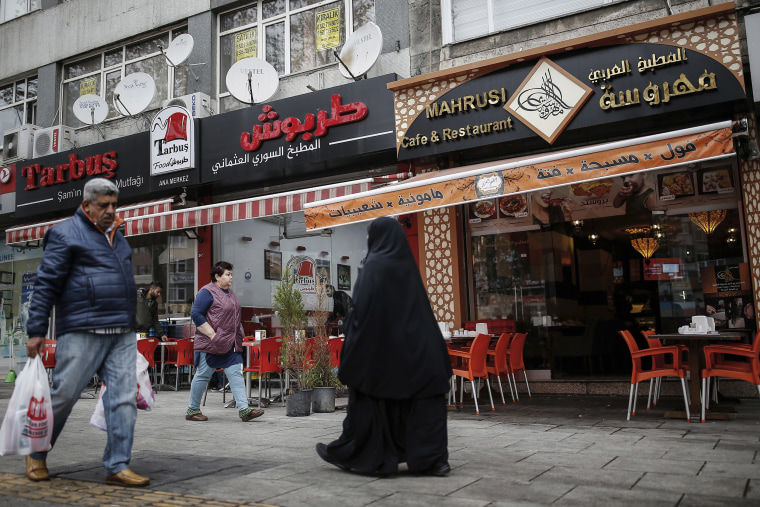 Image: People walk in the Fatih district in Istanbul