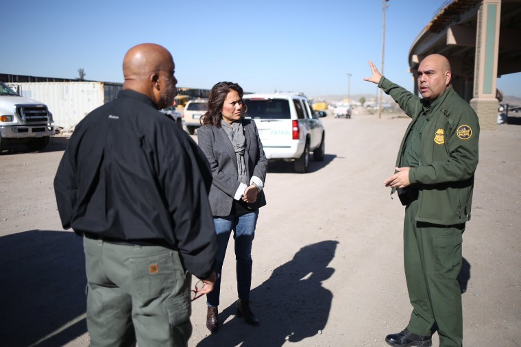 Rep. Veronica Escobar, D-Texas, and Rep. Bennie Thompson, D-Miss, chairman of the House Homeland Security Committee, discuss the border with a Customs and Border Patrol agent on a tour in El Paso that Escobar led on Feb. 22, 2019.
