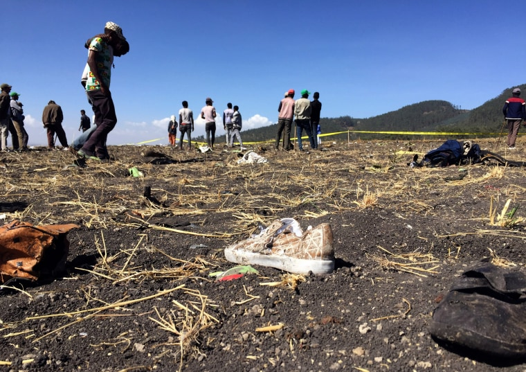 Image: People look at the scene of the Ethiopian Airlines crash near the town of Bishoftu, southeast of Addis Ababa, on March 10, 2019.