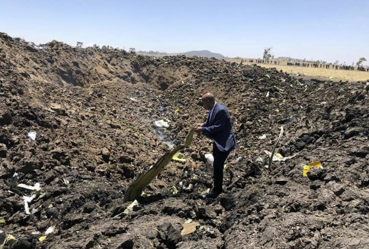 Image: Tewolde Gebremariam, the CEO of Ethiopian Airlines, looks at the wreckage of a plane that crashed after takeoff from Addis Ababa on March 10, 2019. The crash killed all 157 people on board.