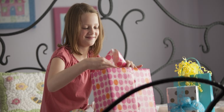 Young girl wrapping presents
