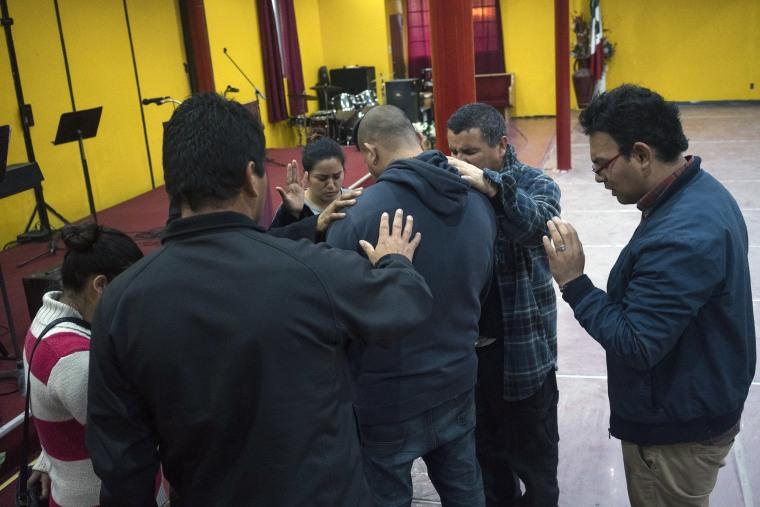 Image: Albert during a prayer ceremony at the Christian shelter Agape Misión in Tijuana.