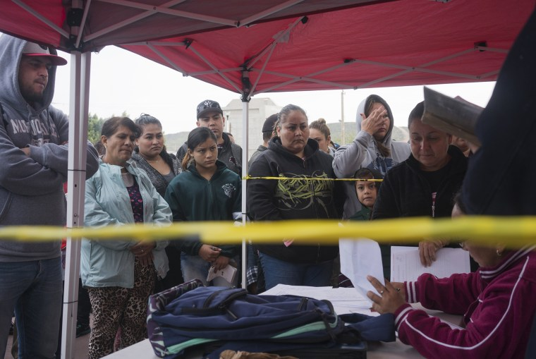 """Migrants wait their turn to be called and seek asylum in the United States at """"El chaparral"""" in Tijuana, Mexico."""