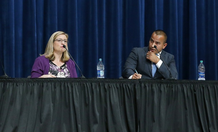 Kate Gallego and Daniel Valenzuela, both Democrats, at a mayoral debate on Sept. 27, 2018, in Phoenix.