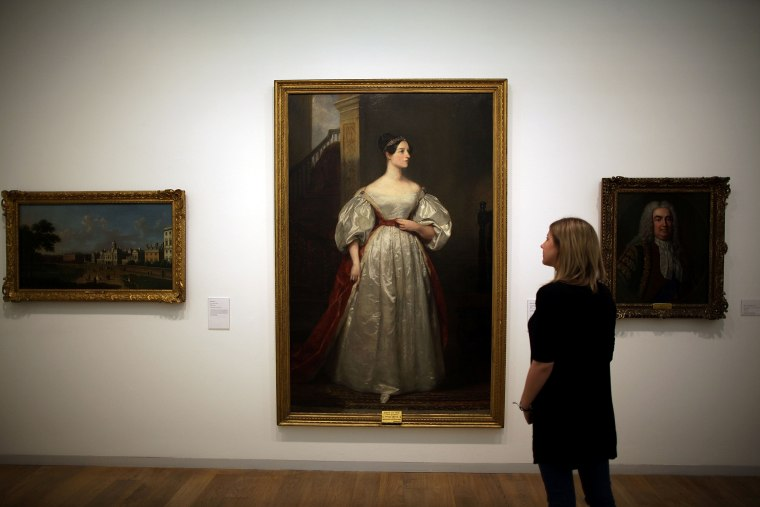"Image: A gallery employee looks at Margaret Carpenter's painting ""Ada Lovelace (1815-1852)"" at the Whitechapel Gallery exhibition in London on March 9, 2012."